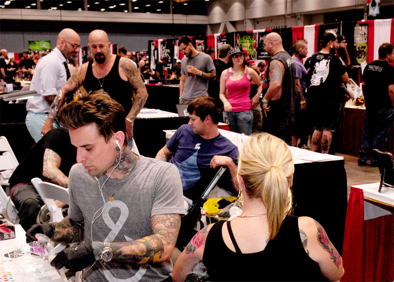 Images: Event flyer & London Reese tattooing at convention [Click for ...